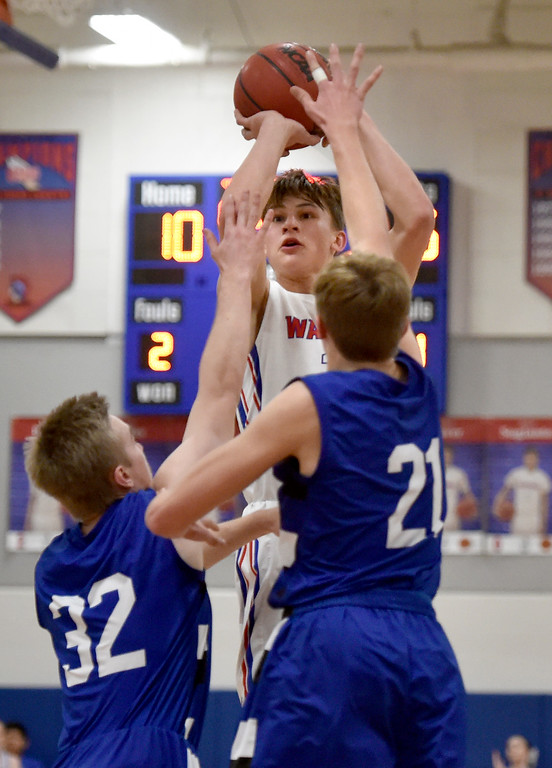 . LAFAYETTE, CO - FEBRUARY 5, 2019: Centaurus High School\'s Owen Koonce takes a shot over Beck Page, left, and Dallas Dye during a CHSAA basketball game against Longmont on Tuesday in Lafayette. More photos: BoCoPreps.com (Photo by Jeremy Papasso/Staff Photographer)