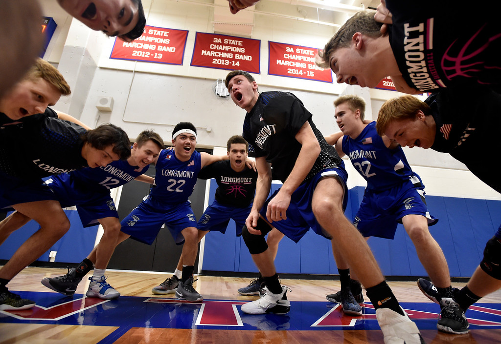 . LAFAYETTE, CO - FEBRUARY 5, 2019: Longmont High School\'s Matt Sprecher, at center, gets his teammates pumped up in a team huddle before the start of a CHSAA basketball game against Centaurus on Tuesday in Lafayette. More photos: BoCoPreps.com (Photo by Jeremy Papasso/Staff Photographer)