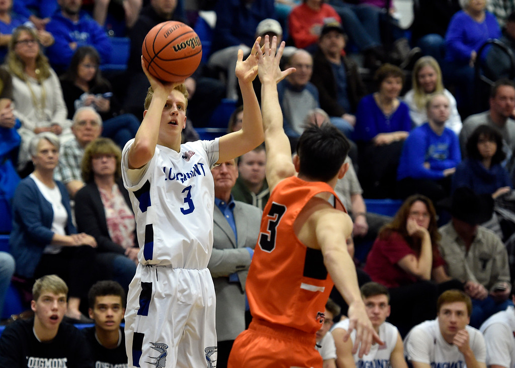 . LONGMONT, CO - JANUARY 25, 2019: Longmont High School\'s Ryan Schneider takes a shot over Gavan Blackburn during a game against Greeley Central on Friday in Longmont. More photos: BoCoPreps.com (Photo by Jeremy Papasso/Staff Photographer)