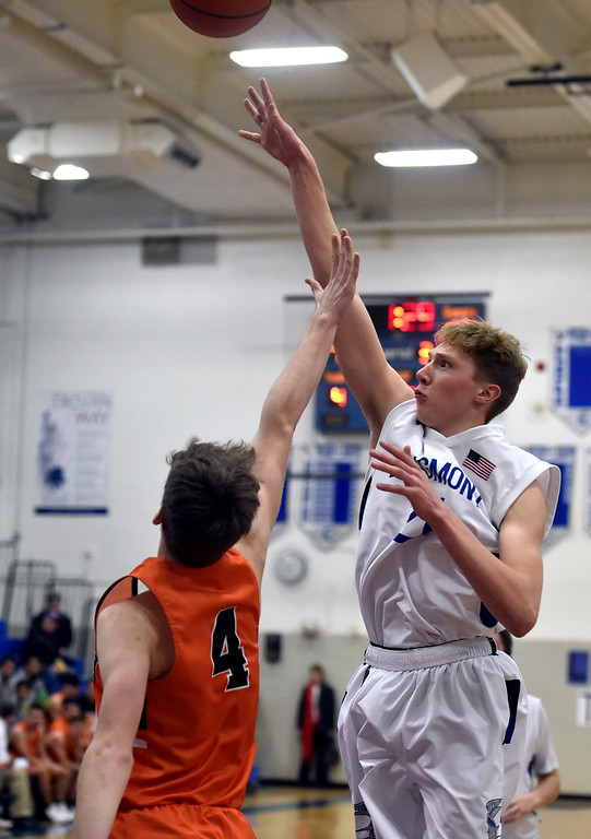 . LONGMONT, CO - JANUARY 25, 2019: Longmont High School\'s Dallas Dye takes a shot over Ben Kingsford during a game against Greeley Central on Friday in Longmont. More photos: BoCoPreps.com (Photo by Jeremy Papasso/Staff Photographer)