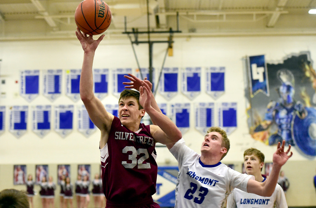 . Silver Creek High School\'s Trevor Riters takes a shot over Caden Dion during a game against Longmont on Thursday in Longmont. More photos: BoCoPreps.com Jeremy Papasso/ Staff Photographer 02/08/2018