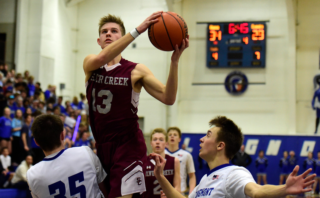 . Silver Creek High School\'s Christian Warner drives to the hoop during a game against Longmont on Thursday in Longmont. More photos: BoCoPreps.com Jeremy Papasso/ Staff Photographer 02/08/2018