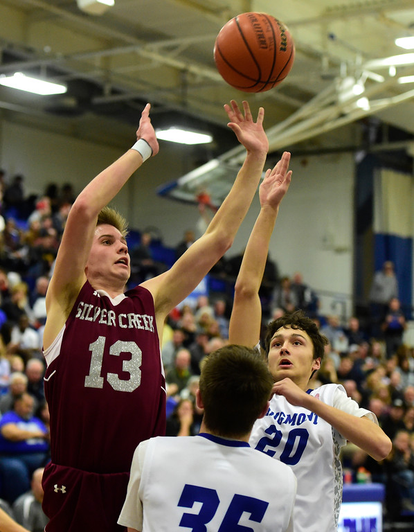 . Silver Creek High School\'s Christian Warner takes a shot during a game against Longmont on Thursday in Longmont. More photos: BoCoPreps.com Jeremy Papasso/ Staff Photographer 02/08/2018
