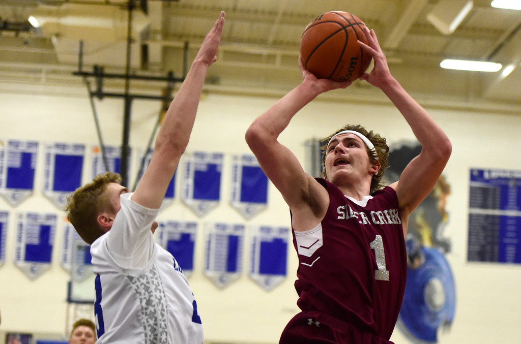 . Silver Creek High School\'s Nick Eaton takes a shot during a game against Longmont on Thursday in Longmont. More photos: BoCoPreps.com Jeremy Papasso/ Staff Photographer 02/08/2018