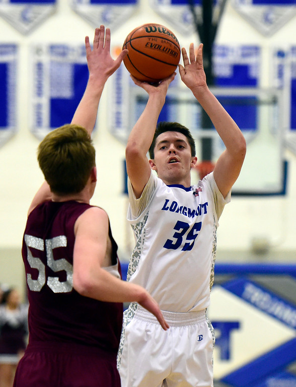 . Longmont High School\'s Calvin Seamons takes a shot over Erik Grossaint during a game against Silver Creek on Thursday in Longmont. More photos: BoCoPreps.com Jeremy Papasso/ Staff Photographer 02/08/2018