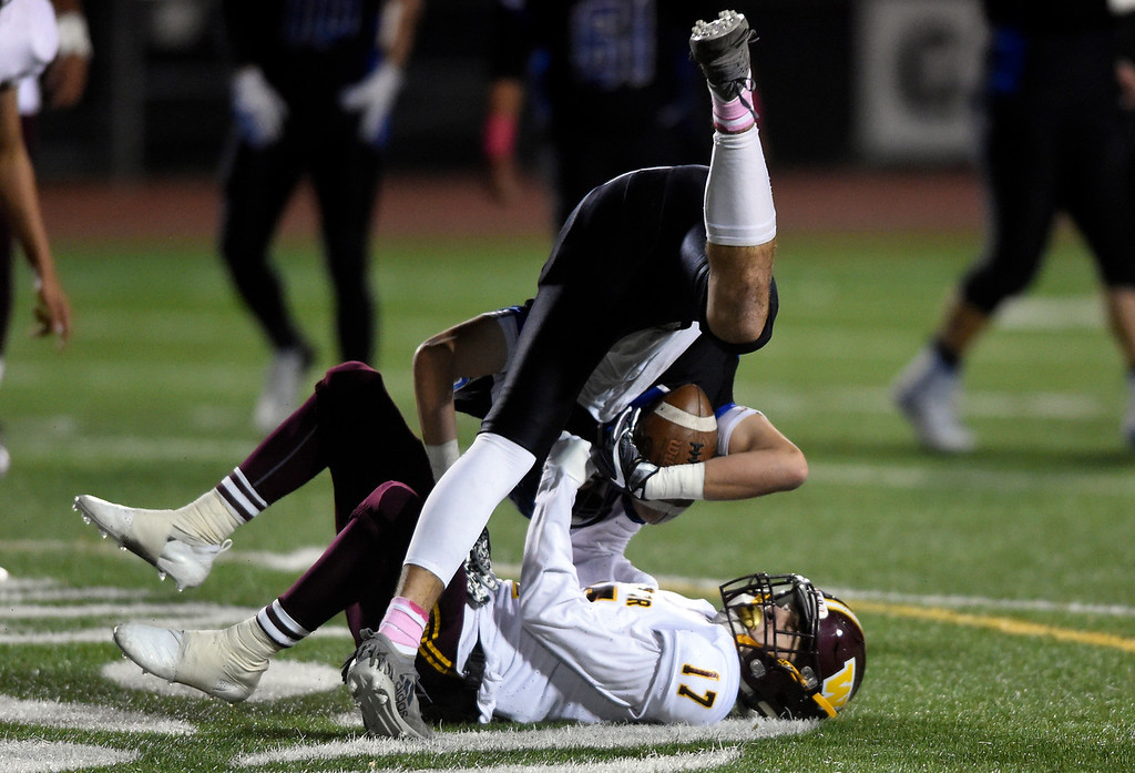 . LONGMONT, CO - OCTOBER 11, 2018: Longmont High School\'s Sage Yazzie is taken down by Darren Peeples after making a catch during a CHSAA football game against Windsor on Thursday in Longmont. More photos: BoCoPreps.com (Photo by Jeremy Papasso/Staff Photographer)