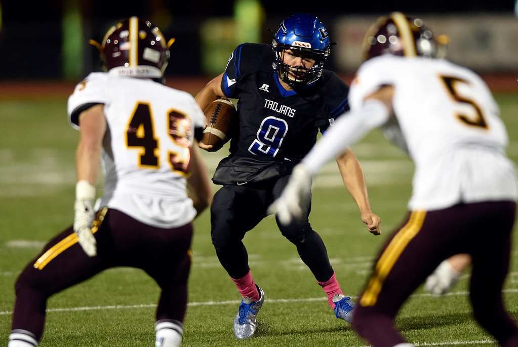. LONGMONT, CO - OCTOBER 11, 2018: Longmont High School quarterback Oakley Dehning runs the ball during a CHSAA football game against Windsor on Thursday in Longmont. More photos: BoCoPreps.com (Photo by Jeremy Papasso/Staff Photographer)