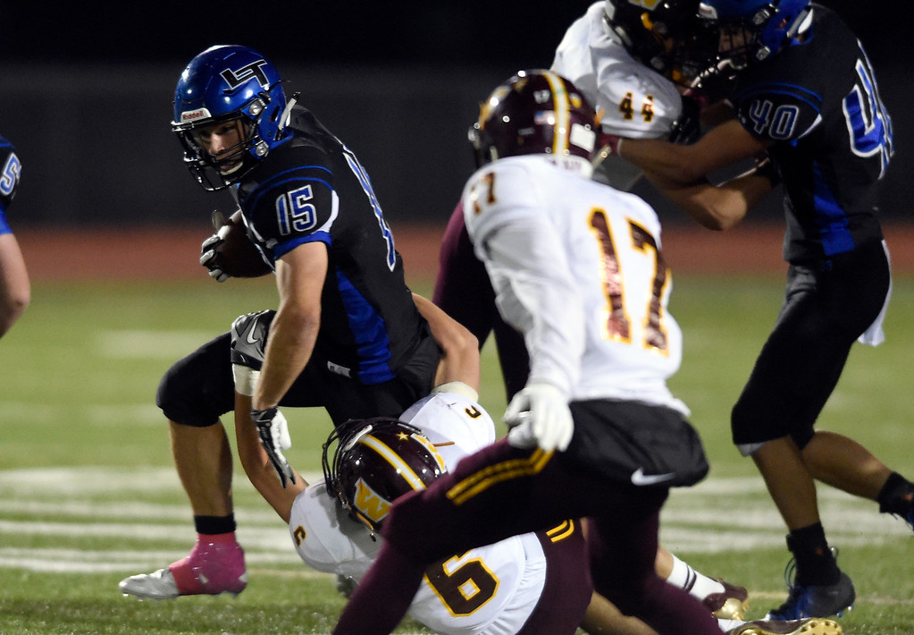 . LONGMONT, CO - OCTOBER 11, 2018: Longmont High School\'s Drake Engelking tries to break a tackle from Brady Bohlinger during a CHSAA football game against Windsor on Thursday in Longmont. More photos: BoCoPreps.com (Photo by Jeremy Papasso/Staff Photographer)