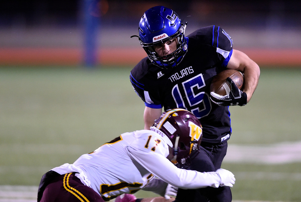 . LONGMONT, CO - OCTOBER 11, 2018: Longmont High School\'s Drake Engelking tries to avoid a tackle from Darren Peeples during a CHSAA football game against Windsor on Thursday in Longmont. More photos: BoCoPreps.com (Photo by Jeremy Papasso/Staff Photographer)