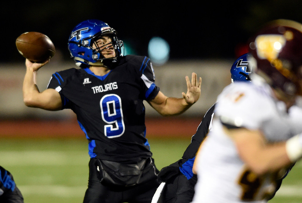 . LONGMONT, CO - OCTOBER 11, 2018: Longmont High School\'s Oakley Dehning throws a pass during a CHSAA football game against Windsor on Thursday in Longmont. More photos: BoCoPreps.com (Photo by Jeremy Papasso/Staff Photographer)