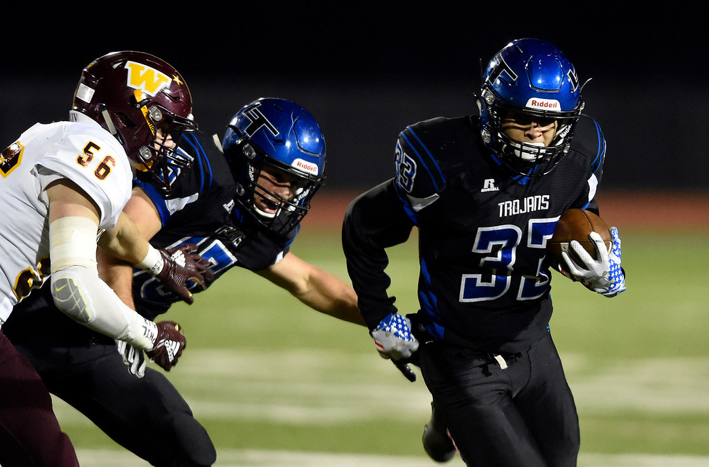 . LONGMONT, CO - OCTOBER 11, 2018: Longmont High School\'s Cruz Garcia runs the ball during a CHSAA football game against Windsor on Thursday in Longmont. More photos: BoCoPreps.com (Photo by Jeremy Papasso/Staff Photographer)