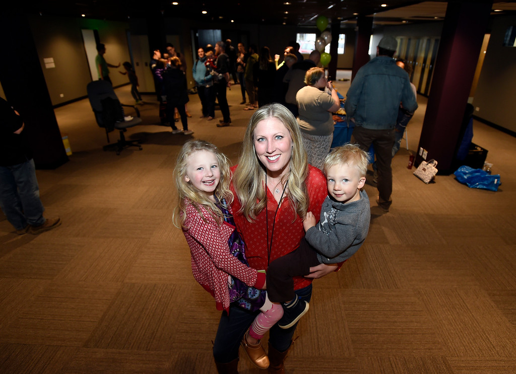 . CoSolve founder and Executive Director Melanie Piazza holds her children Amalia, 5, left, and Gus, 2, during the grand opening of the new CoSolve coworking space on Friday at 350 Terry Street in Longmont. For more photos of the grand opening go to dailycamera.com Jeremy Papasso/ Staff Photographer 04/13/2018