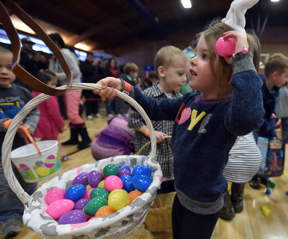 "Marlo Epstein, 3 1/2, shows her mother her basket full of eggs and candy during the Easter Egg Hunt at the Longmont Memorial Center on Saturday sponsored by the White Fields Church.<br /> More photos:  <a href=""http://www.BoCoPreps.com"">http://www.BoCoPreps.com</a><br /> David R. Jennings/Staff Photographer<br /> March 26, 2016"