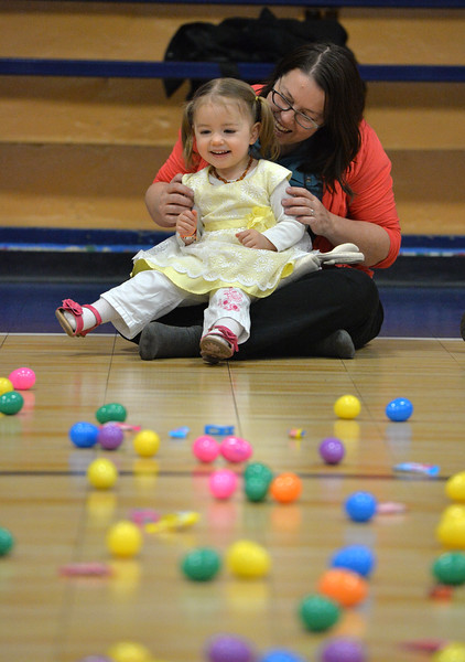 "Celeste Martinez, 2, waits with her mother Eydie Cady for the Easter Egg Hunt at the Longmont Memorial Center on Saturday sponsored by the White Fields Church.<br /> More photos:  <a href=""http://www.BoCoPreps.com"">http://www.BoCoPreps.com</a><br /> David R. Jennings/Staff Photographer<br /> March 26, 2016"