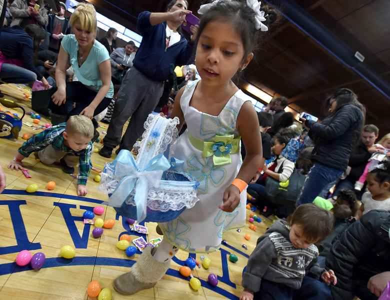 "BEST 1) Cristel Zavala, 5, gathers eggs and candy during the Easter Egg Hunt at the Longmont Memorial Center on Saturday sponsored by the White Fields Church.<br /> More photos:  <a href=""http://www.BoCoPreps.com"">http://www.BoCoPreps.com</a><br /> David R. Jennings/Staff Photographer<br /> March 26, 2016"