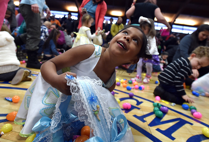 Cristel Zavala, 5, gathers eggs and candy during the Easter Egg Hunt at the Longmont Memorial Center on Saturday sponsored by the White Fields Church.<br /> <br /> David R. Jennings/Staff Photographer<br /> March 26, 2016
