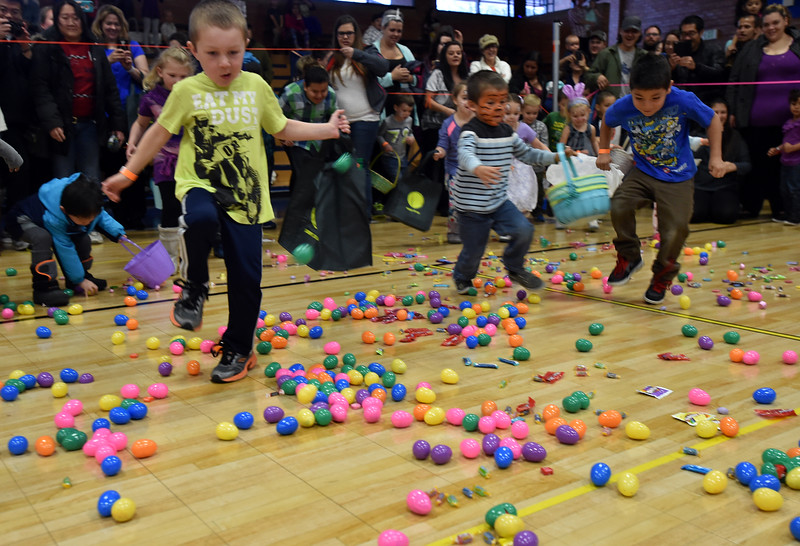"Four and five year olds run to gather eggs and candy during the Easter Egg Hunt at the Longmont Memorial Center on Saturday sponsored by the White Fields Church.<br /> More photos:  <a href=""http://www.BoCoPreps.com"">http://www.BoCoPreps.com</a><br /> David R. Jennings/Staff Photographer<br /> March 26, 2016"