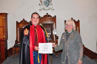 Adam receiving the Masonic Youth Scholarship Award for $1,000.00 from the Grand Chapter of Nebraska, Order of the Eastern Star. Presented by Dottie Arent, Associate Grand Matron.