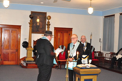 Bro. Don Coash receiving his Master Masons Diploma from Worshipful Master Jeremiah Schartz