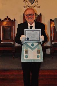 Bro. Don Coash receiving his Master Masons Diploma and White Gloves.
