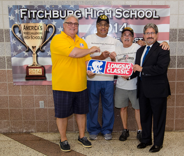Donn Ingemie, second from left, presents a check from the Longsjo Association to the New Patriots Veterans Outreach Center on Friday afternoon. Also pictured are Bob Lyle, Daniel Richard and Mayor Stephen DiNatale. SENTINEL & ENTERPRISE / Ashley Green