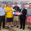 Donn Ingemie, second from left, presents a check from the Longsjo Association to the Fitchburg High athletic department on Friday afternoon. From left is Principal Jeremy Roche, Jack Scott, Mayor Stephen DiNatale and athletic director Ray Cosenza. SENTINEL & ENTERPRISE / Ashley Green