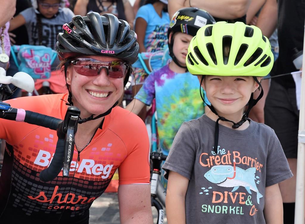 . Julianne Tauscher  helps  her son, Owen Tauscher get ready for a kids race.  Julianne raced in the Women\'s Pro Division of the Longsjo Classic. Sentinel & Enterprise - Jim Fay