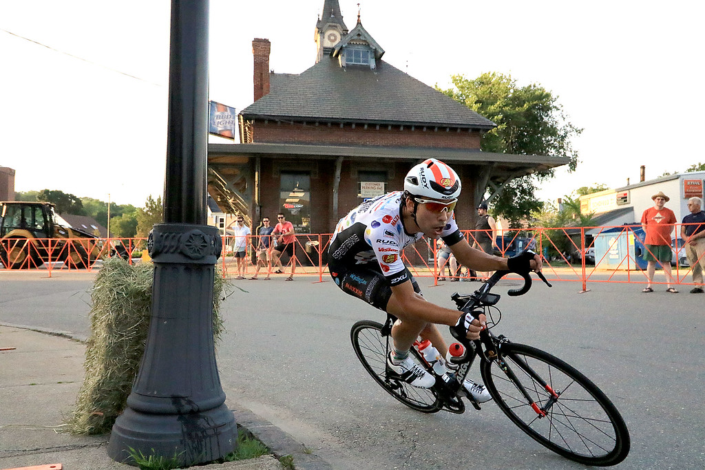 . Rider Richard Furchtgott comes around the corner at Depot Square in the Men\'s Pro Cat 1/2 race during the first day of the Longsjo Classic in Leominster on Saturday. SENTINEL & ENTERPRISE/JOHN LOVE