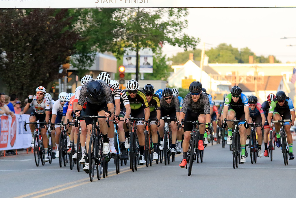 . Riders come up West street in the Men\'s Pro Cat 1/2 race during the first day of the Longsjo Classic in Leominster on Saturday. SENTINEL & ENTERPRISE/JOHN LOVE