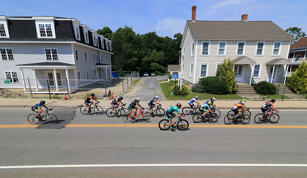. Women\'s Cat 4/5 racer head down Merriam Street in Leominster on Saturday during the Longsjo Classsic. SENTINEL & ENTERPRISE/JOHN LOVE