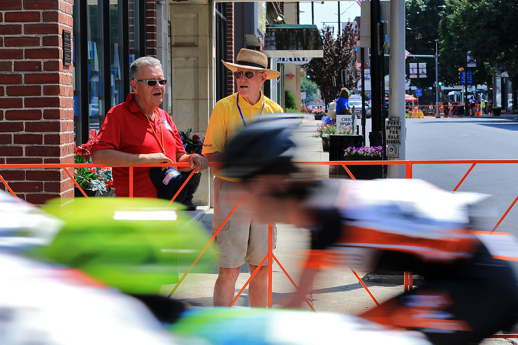 . Tom Longsjo, in red shirt, the brother of Art Longsjo and Dick Ring watch the Women\'s Cat 4/5 race on Main Street in Leominster on Saturday. SENTINEL & ENTERPRISE/JOHN LOVE