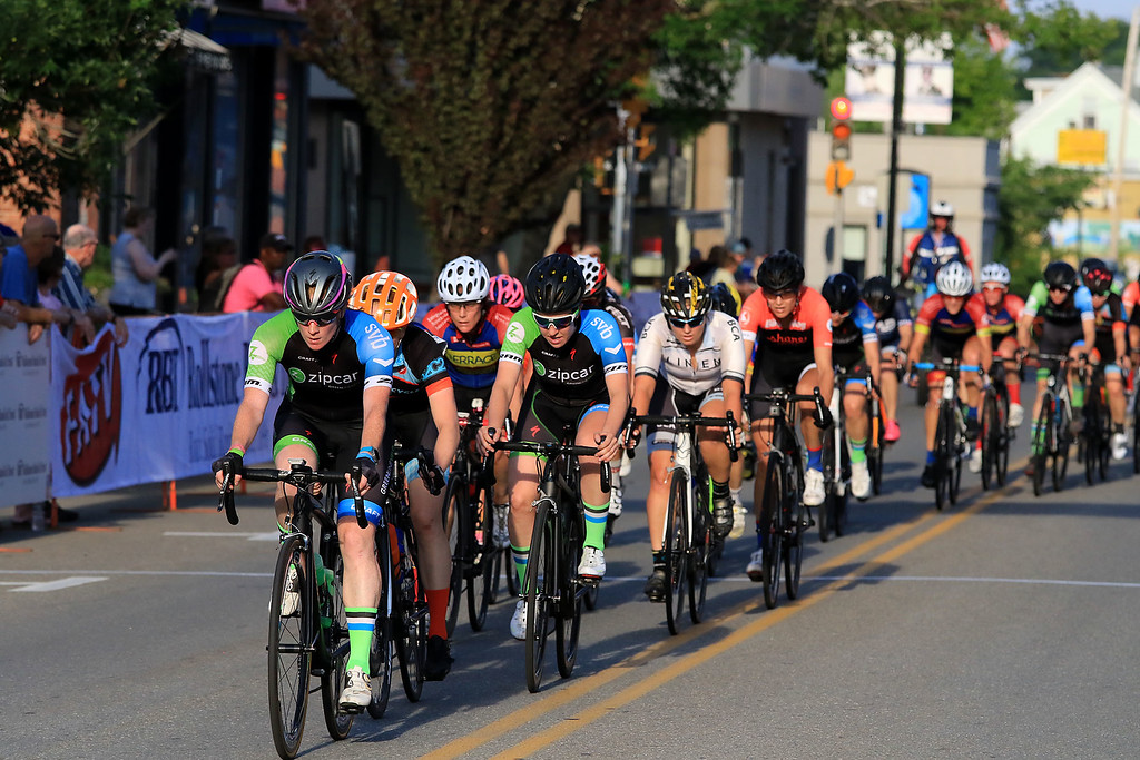 . The peloton in the Women\'s Pro C 1/2 race rides up West Street during the first day of the Longsjo Classic on Saturday in Leominster. SENTINEL & ENTERPRISE/JOHN LOVE