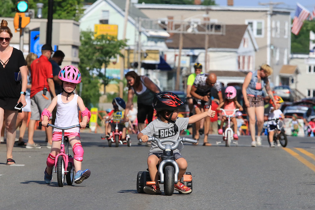 . Liam Crawford, 4 center, of Leominster competes in one of the kids races during the Longsjo Classic on Saturday in Leominster. SENTINEL & ENTERPRISE/JOHN LOVE