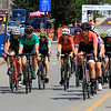 Riders in the Women's Cat 4/5 get ready to turn the corner from West Street onto Court Street during Longsjo Classic in Leominster on Saturday. SENTINEL & ENTERPRISE/JOHN LOVE