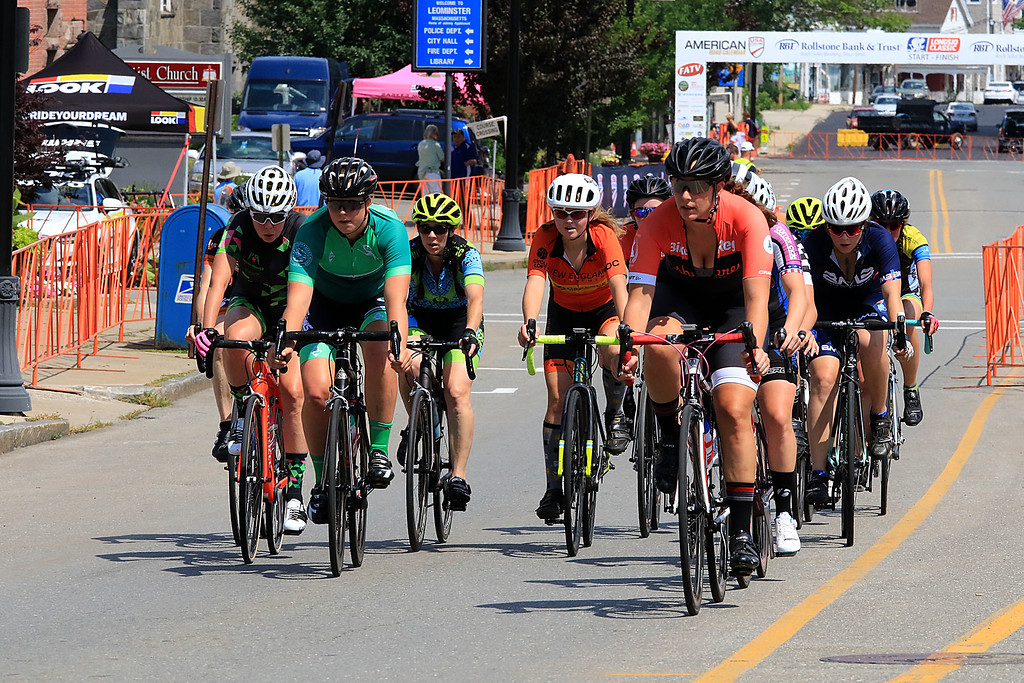 . Riders in the Women\'s Cat 4/5 get ready to turn the corner from West Street onto Court Street during Longsjo Classic in Leominster on Saturday. SENTINEL & ENTERPRISE/JOHN LOVE