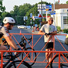 A guy out on his bike stop on Main Street to watch the riders go by in the Men's Pro Cat 1/2 race during the first day of the Longsjo Classic in Leominster on Saturday. SENTINEL & ENTERPRISE/JOHN LOVE