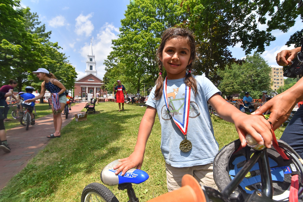 . Kid\'s race winner Yuma Constantine, 4, poses with her bike during the 2018 Longsjo Classic in Fitchburg on Sunday.  SENTINEL & ENTERPRiSE JEFF PORTER