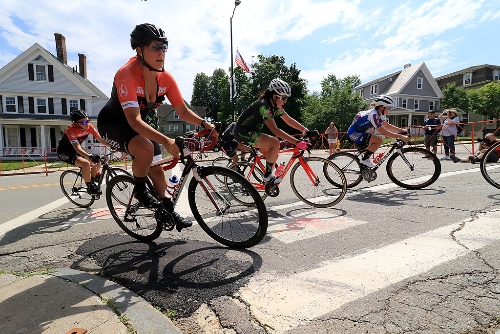 . Riders in the Women\'s Cat 4/5 turn the corner from Court Street onto Merriam Avenue during Longsjo Classic in Leominster on Saturday. SENTINEL & ENTERPRISE/JOHN LOVE