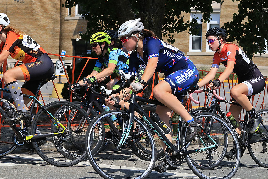 . Riders in the Women\'s Cat 4/5 turn the corner from West Street onto Court Street during Longsjo Classic in Leominster on Saturday. SENTINEL & ENTERPRISE/JOHN LOVE
