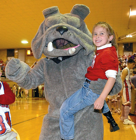 Morgan Wilson, 6, gets a chance to dance with the bulldog at a St. Anthony High School basketball game in 2003.<br /> Eric Williams photo