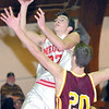 Neoga High School No. 22 Joe Burton and Dieterich High School No. 20 Chris Behrns are shown in this 2003 photo.