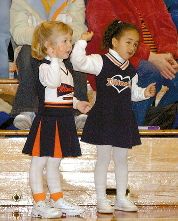 In this 2003 photo, Natalie White, 4, left, and Ariel Richard, 4, come dressed to cheer on the Newton Central 8th grade boys basketball team at the class 8A sectional at Goff Gym in Effingham. Newton defeated Dieterich to advance to the state tournament.<br /> Eric Williams photo