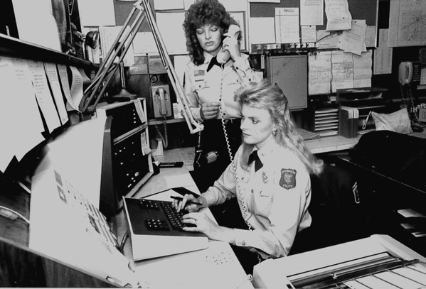 City telecommunicators Linda Henry (back) and Jodi Moomaw , 1988