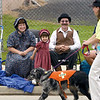 Alexis Torbeck, 4, watches Laura Hale and Isaac, with Mid America Search and Rescue, go by during the Sesquicentennial parade as Jay and Ruth Kersey look on in this 2003 photo.<br /> Eric Williams photo