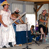 Lee Hord, from left to right, Roger Keller and Duane Sapp perform as part of the Hillbilly Chicks during the Watson Area Not So Beauty Pageant as part of the Watson Homecoming Celebration in 2003.    Eric Williams photo