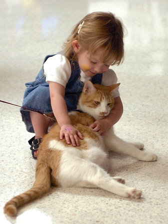 Madelyn Smothers makes a new friend at the Effingham Humane Society's Adopt-a-thon in this 2003 photo at the Village Square Mall in Effingham.<br /> Eric Williams photo