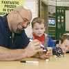 Former Chicago Bear Chris Zorich, left, signs an autograph for Andrew Brink, 5, center and Ian Brink, 9, during the grand opening of Menards in Effingham in 2003. The Brinks who are big Chicago sports fans came from Casey to get to meet Zorich and get his autograph.<br /> Eric Williams photo