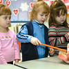 In this 2003 photo, Taylor Dammerman, left, and Ali Price, right, look on as Mia Jones practices brushing teeth the way a dental hygienist from Dr. Charles Horin's office showed the students at The Sunshine Company Preschool at the Effingham YMCA. The students learned about the ways to take care of their teeth as part of National Child Dental Hygiene Month.<br /> Eric Williams photo