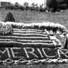 "in this 1970 photo taken in Altamont, Edward Torbeck, 70, stands beside a floral design of an American flag along with the message ""God Bless America"" he created with 2,019 plants. The retired St. Louis barber said at the time he had happy flowers because he gives them a drink of a beer solution twice a  month."
