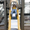 Cortney Mosier, 7, takes a trip down one of the slides at Community Park in Effingham as she gets out to enjoy the warm weather Saturday afternoon. With temperatures reaching into the sixties the area parks were busy places with people getting out for a taste of spring.<br /> Eric Williams photo